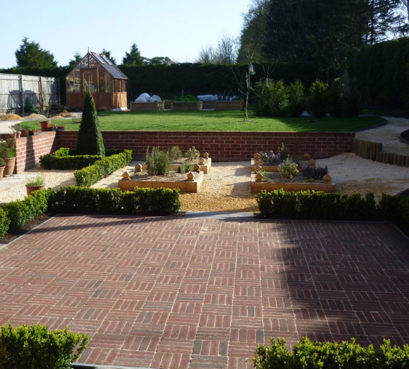 Brick paving and raised Oak herb beds, Newmarket