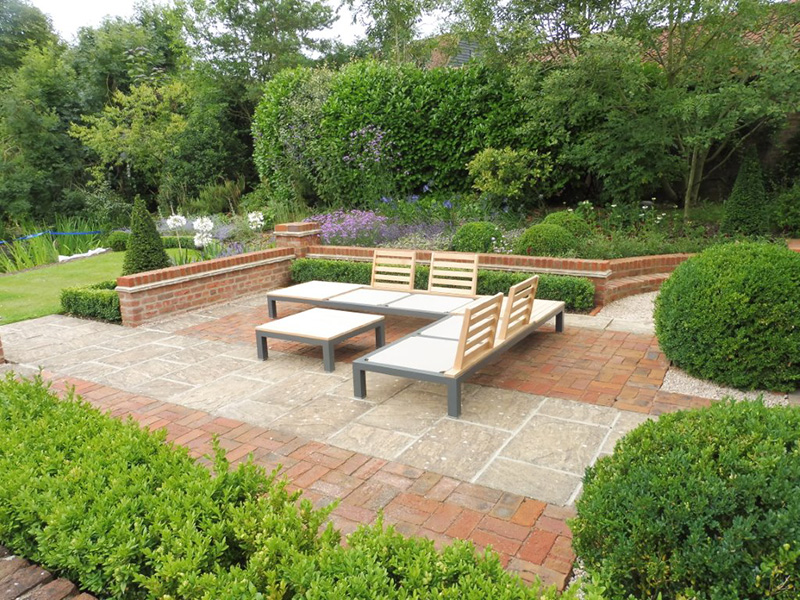 Brick and stone terrace, walling and planting Private garden