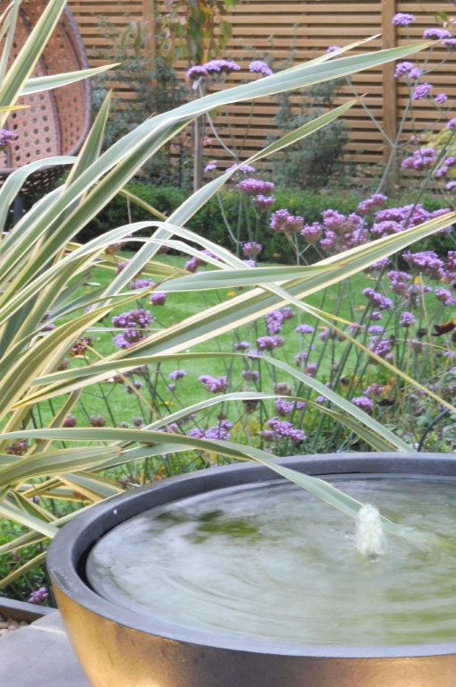 Private garden , Faux lead bowl water feature & verbena